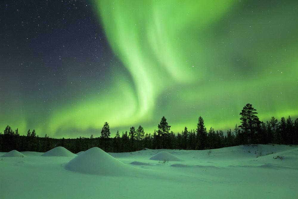 auroras-boreales-lago-Inari-Suecia